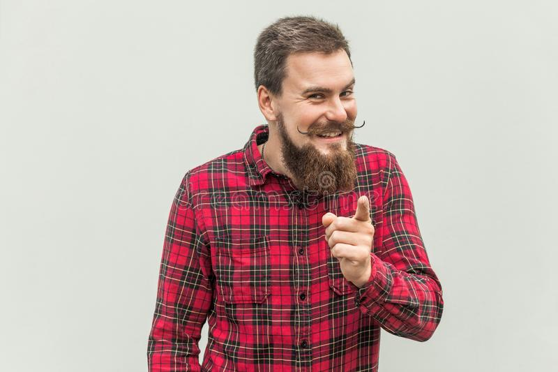 Shame of you! Bearded man in red shirt pointing finger at camera stock photo