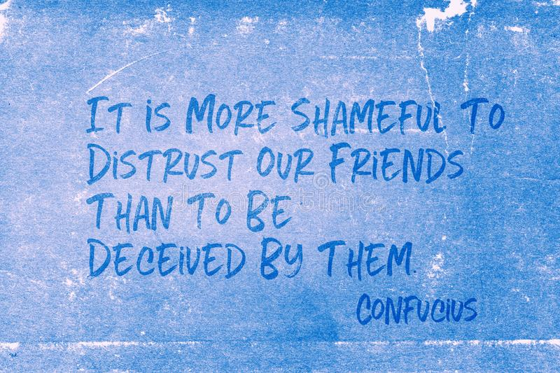 Shameful to distrust Confucius. It is more shameful to distrust our friends than to be deceived by them - ancient Chinese philosopher Confucius quote printed on royalty free stock photos