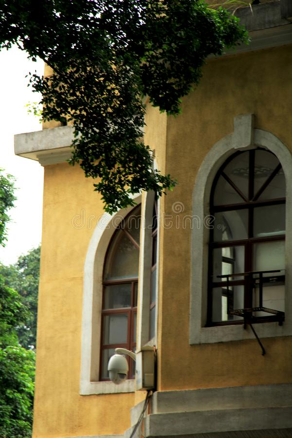 Shamian Guangzhou city historical building. Foreign institution, historical building overseas` style, European style, brics and pillars, old trees. History of stock image