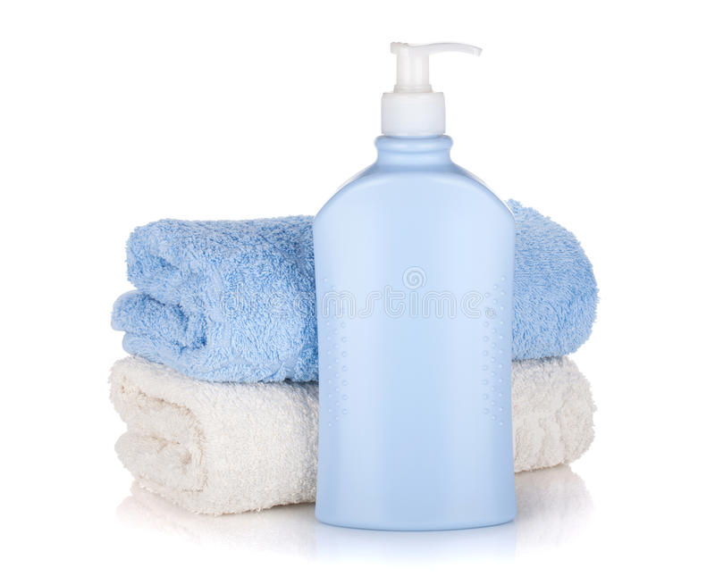 Shampoo Bottle And Towels Royalty Free Stock Photos