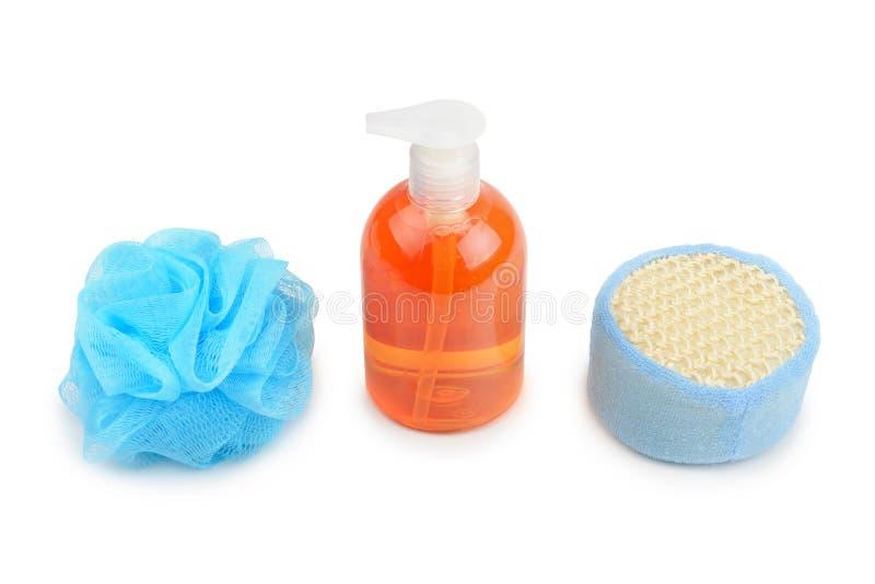 Shampoo en spons stock afbeeldingen