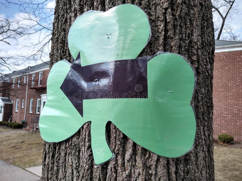 Shamrock With Arrow, 5K Run, Race Event, Rutherford, NJ, USA. Arrow in a shamrock advising runners of the route to follow for a local 5k. This photo was taken in royalty free stock photography