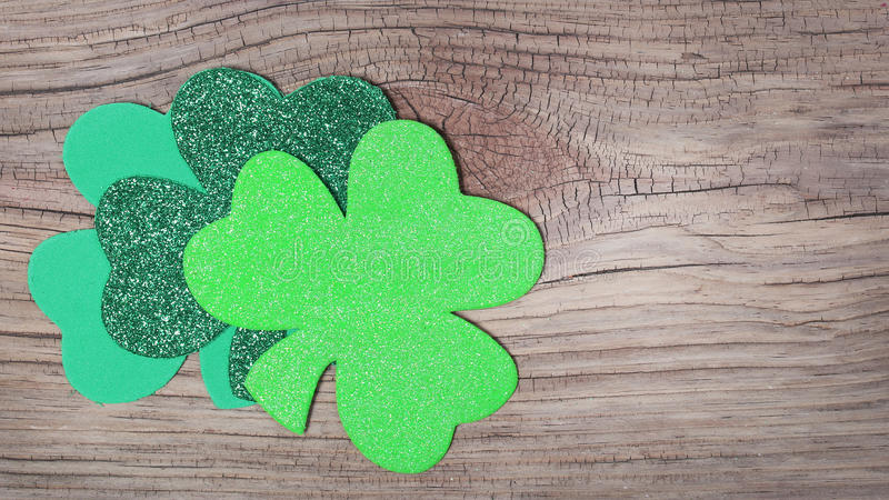 Shamrock over old wood background. Glitter Green Clover. St. Patrick's Day royalty free stock photos