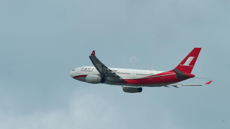 Shanghai Airlines Airbus A330 taking off at Changi Airport. SINGAPORE - DECEMBER 23: Shanghai Airlines Airbus A330 taking off at Changi Airport on December 23 royalty free stock photography