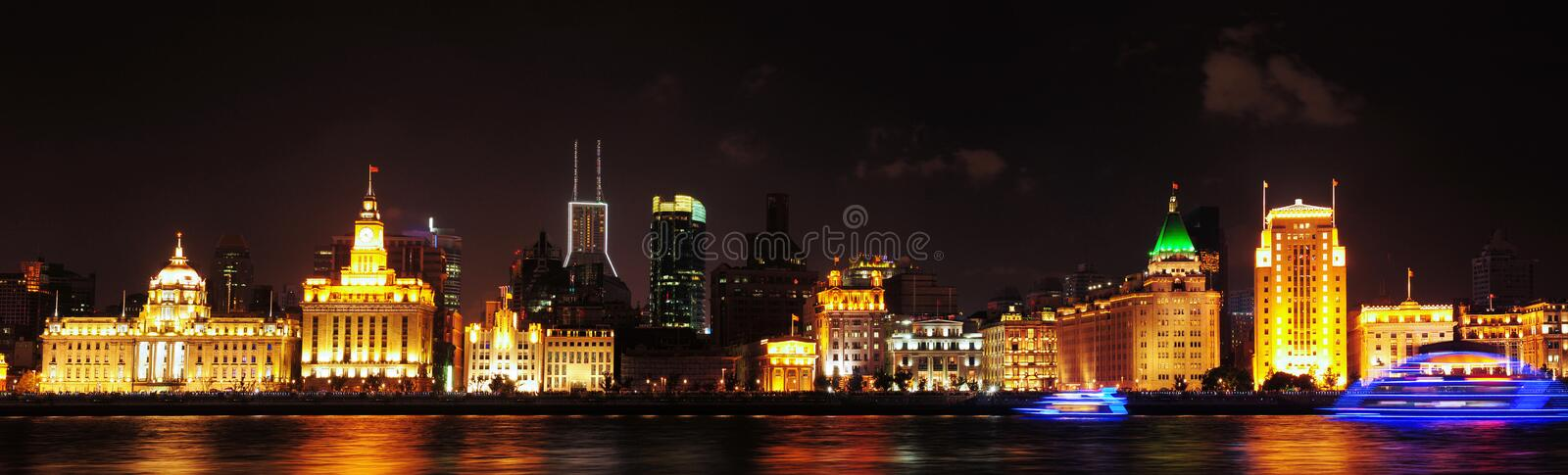 Shanghai Bund night panorama. The Bund is located in downtown Shanghai, Huangpu District Huangpu River, it is the landscape of Shanghai stock images