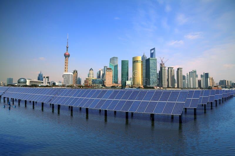 Shanghai Bund skyline landmark at Ecological energy Solar panel stock images
