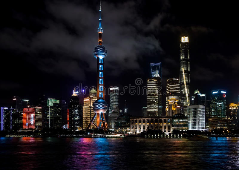 Shanghai, China - August 22, 2017: A night view of the skyscrapers of Lujiazui Pudong New Area at east bank of Huangpu River, loo royalty free stock photo