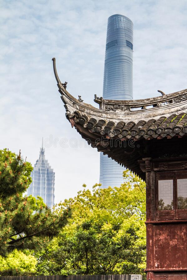 Shanghai, China, Chinese roof on a background of Shanghai Tower royalty free stock photography