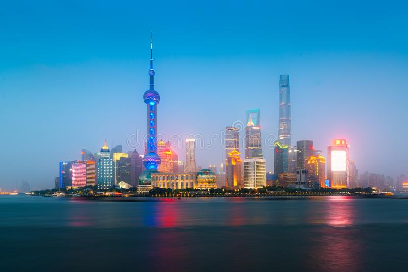Shanghai, China city skyline at night on the Huangpu River.  stock image