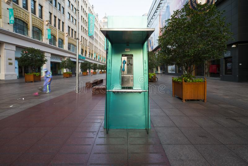 Shanghai, China - 08 12 2016: Green telephone booth also called phone booth, telephone kiosk, telephone call box, telephone box or royalty free stock photography