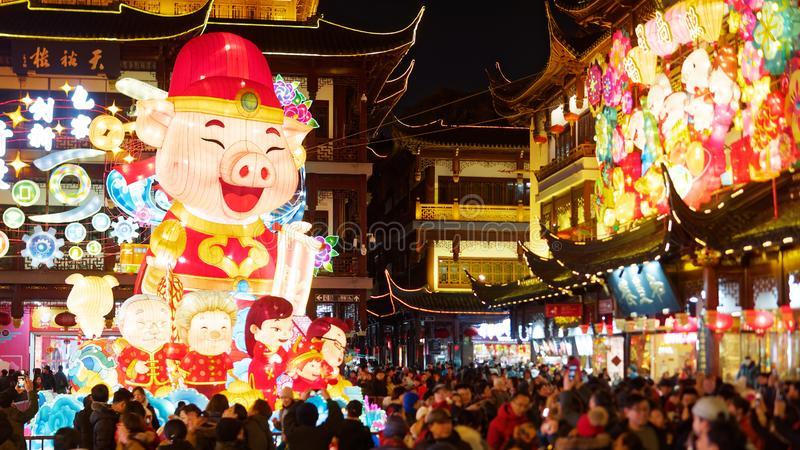 Shanghai, China - Jan. 26, 2019: Lantern Festival in the Chinese New Year Pig year, night view of colorful lanterns and crowded. People walking in Yuyuan Garden royalty free stock photo