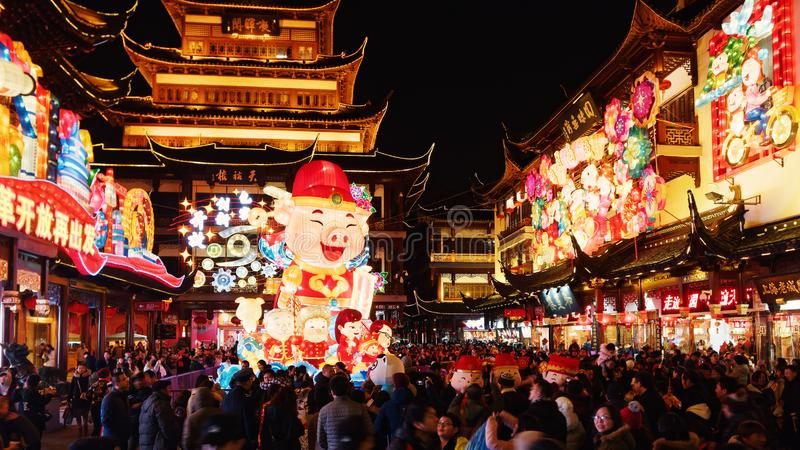 Shanghai, China - Jan. 26, 2019: Lantern Festival in the Chinese New Year Pig year, night view of colorful lanterns and crowded. People walking in Yuyuan Garden stock photography