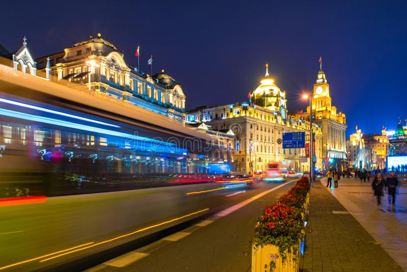 Light trails on the modern building `The Bund` background in shanghai china. royalty free stock photography