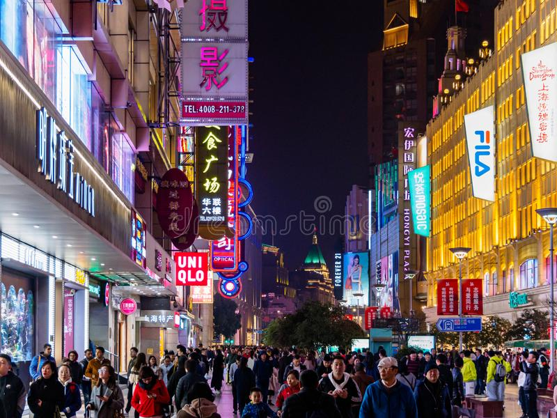 SHANGHAI, CHINA - 12 MAR 2019 - Night /Evening view of the shoppers along the crowded pedestrian street at Nanjing East Road. SHANGHAI, CHINA - 12 MAR 2019 stock images