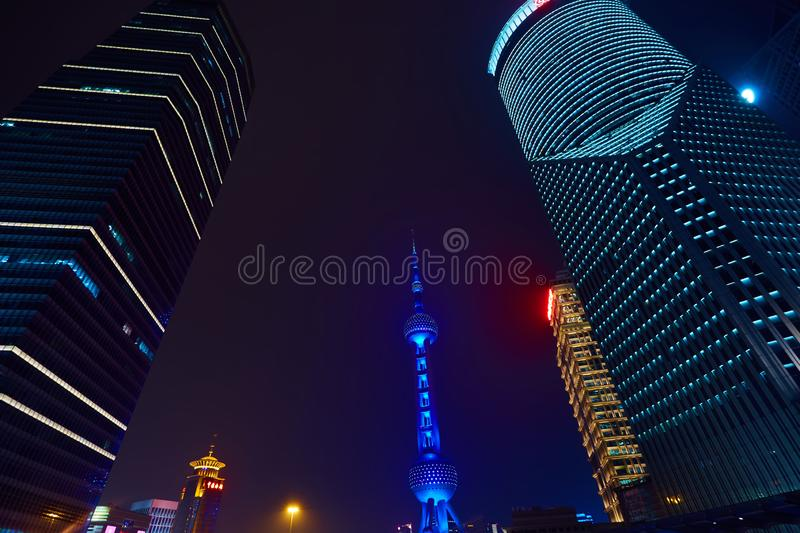Shanghai, China - March 12, 2016: Oriental Pearl TV Tower and commercial buildings located in the Lujiazui financial. District at night stock photo