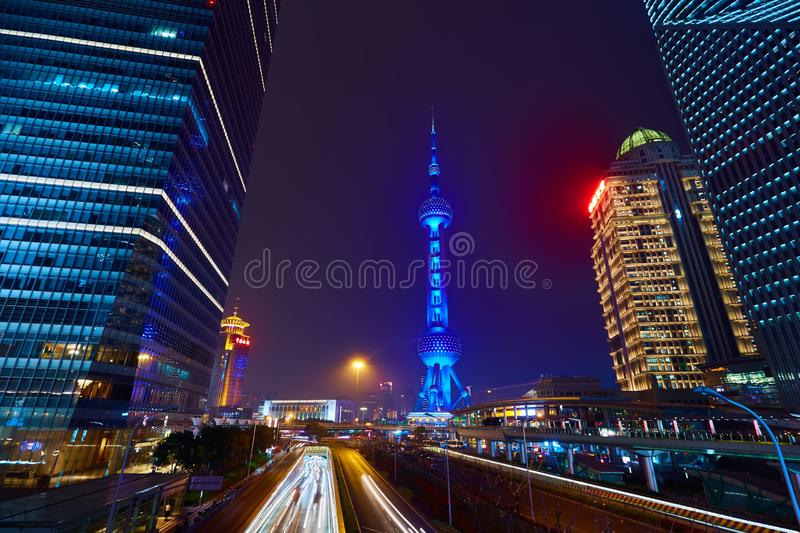 Shanghai, China - March 12, 2016: Oriental Pearl TV Tower and commercial buildings located in the Lujiazui financial. District at night stock images