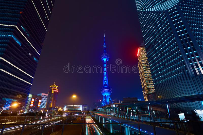 Shanghai, China - March 12, 2016: Oriental Pearl TV Tower and commercial buildings located in the Lujiazui financial. District at night royalty free stock photography