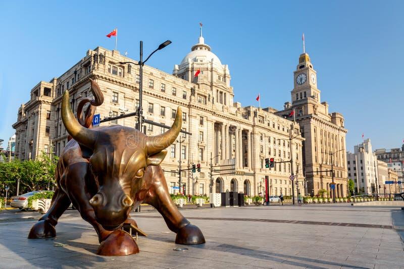 Shanghai, China - May, 2019: Bronze bull on The Bund in Shanghai, Iron bull statue in front of Chinese banks on the Waitan Bund. Promenade, Shanghai royalty free stock image