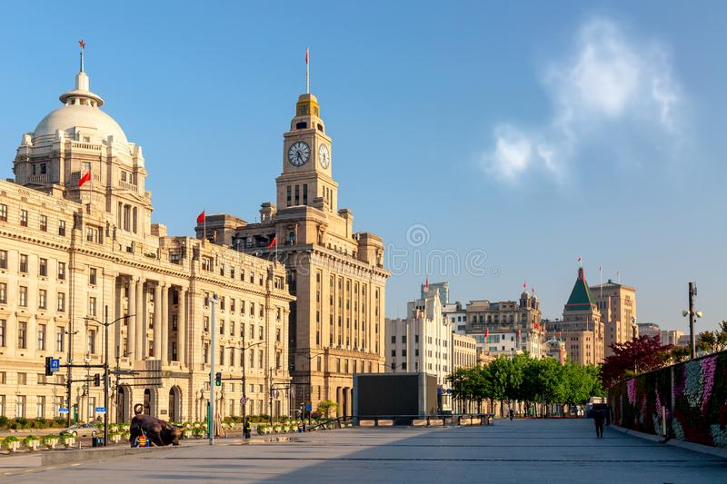 Shanghai, China - May, 2019: Old buildings on the Bund with iron bull statue in front of Chinese banks on the Waitan Bund. Promenade, Shanghai stock photos