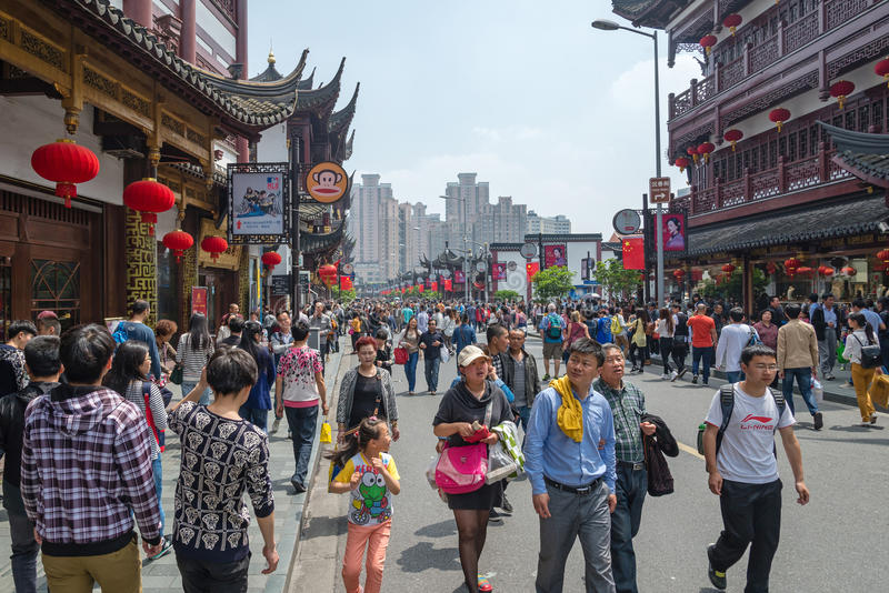 SHANGHAI, CHINA - MAY 3, 2015: people walk on street near the Yu royalty free stock image