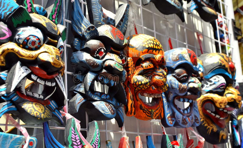 SHANGHAI, CHINA - May 7, 2017 - Souvenir wooden chinese masks on market near Yu Garden, Shanghai stock images