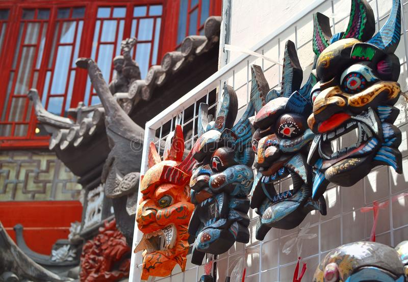 SHANGHAI, CHINA - May 7, 2017 - Souvenir wooden chinese masks on market near Yu Garden, Shanghai stock photo