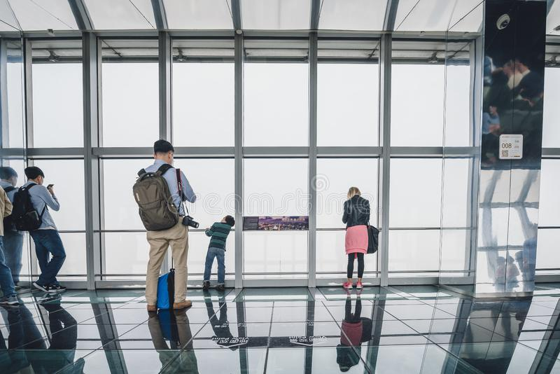Shanghai World Financial Center building Observatory. SHANGHAI, CHINA - MAY 07, 2016: Tourists in Shanghai World Financial Center building Observatory royalty free stock photography