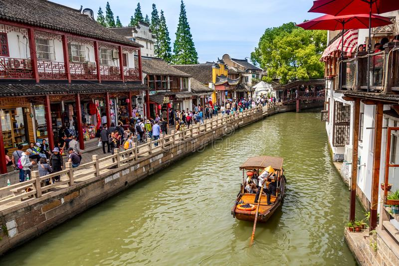Shanghai, China - May, 2019: China traditional tourist boat on canal of Shanghai Zhujiajiao Old Town in Shanghai, China. Chinese royalty free stock photo