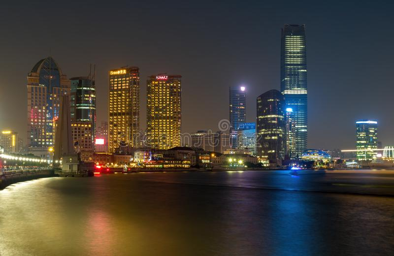 On The Bund - Shanghai City skyline by night. Shanghai, China - Nov 4, 2016: Shanghai City skyline by night. Features the shoreline and Huangpu River. Long stock photo