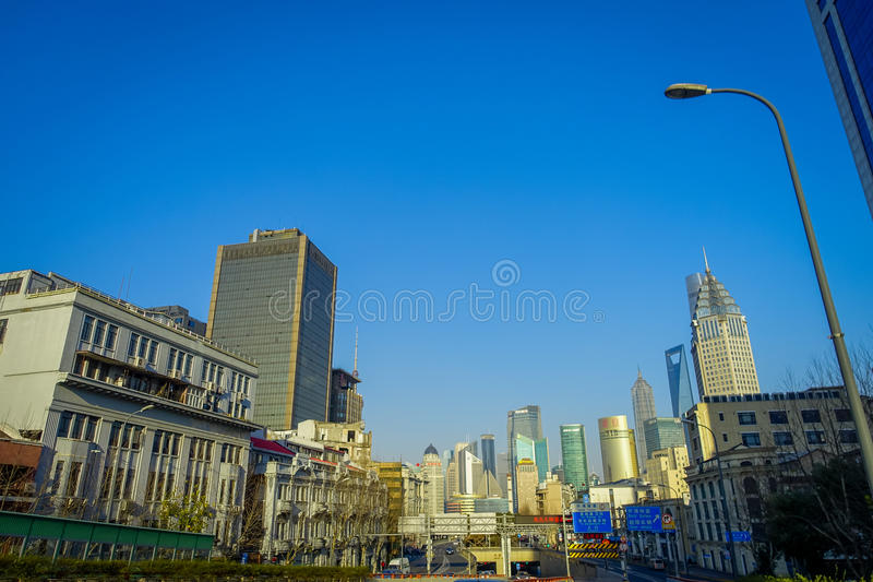 SHANGHAI, CHINA: Some tall modern buildings making up the horizon, walking on the streets of Shanghai royalty free stock photography