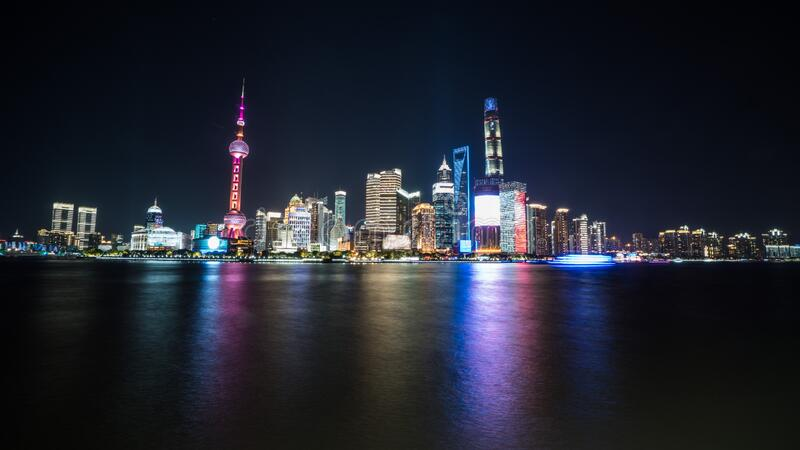 Shanghai, China - 2019 4th November: Panoramic night view of the high buildings of the city seen from the Bund / Waitan stock photography