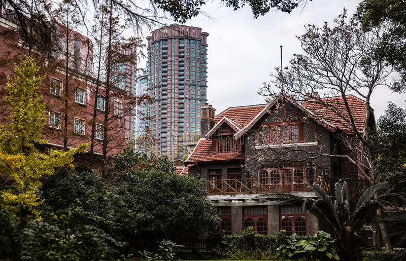 Shanghai China traditional house and modern tower. Shanghai China traditional old house building and new modern skyskraper tower royalty free stock photo