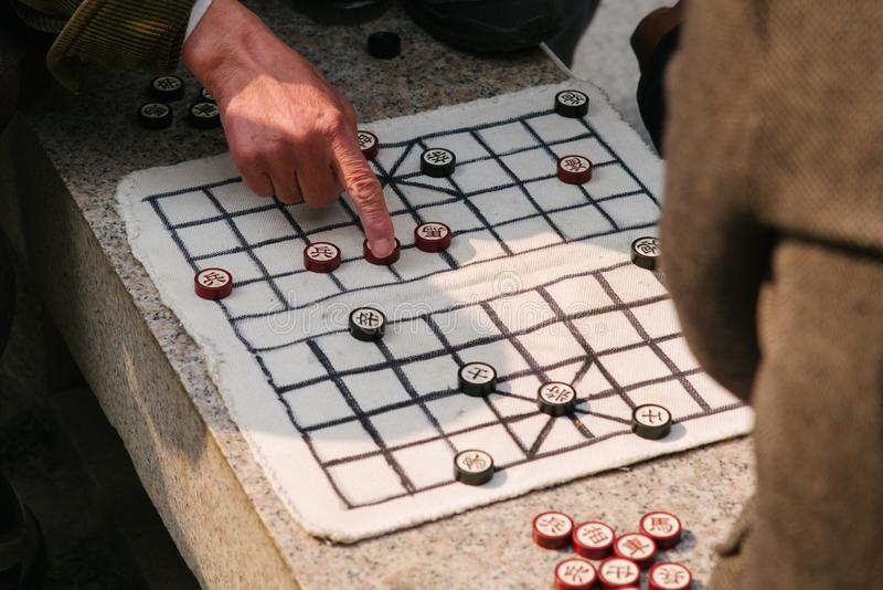 Two old man playing chinese chess xiangqi stock photography