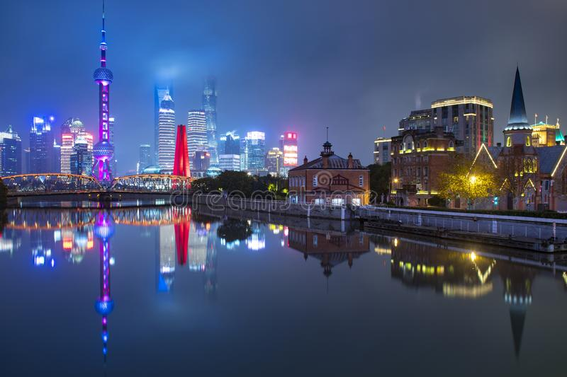 Shanghai city skyline at night with Old and New town. Comparison near by river front royalty free stock image