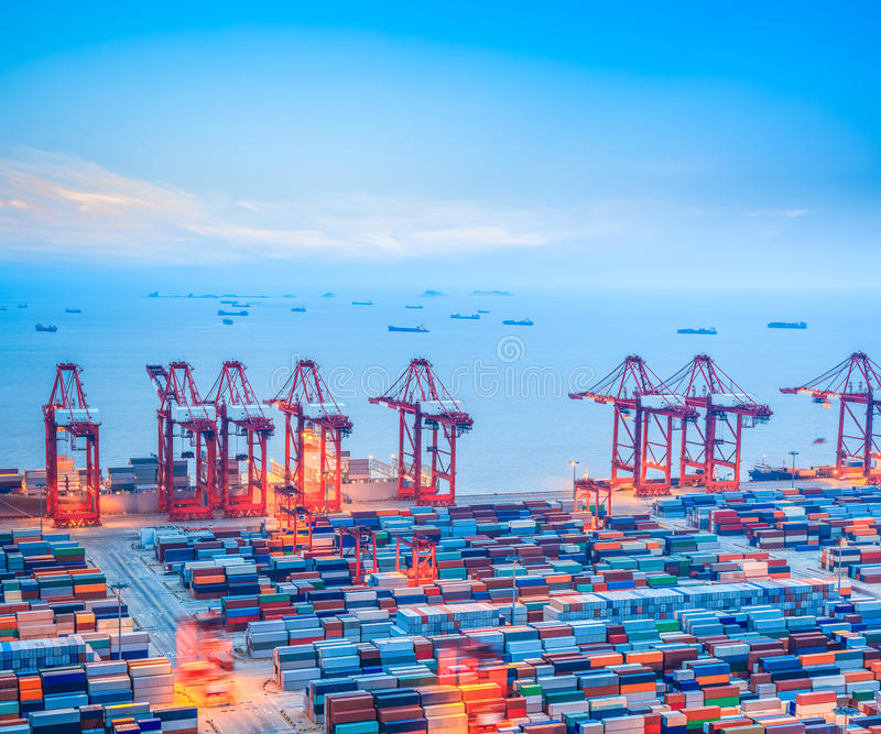 Shanghai Light Industrial Products Import And Export Corporation: Shanghai Container Terminal At Dusk Stock Photo