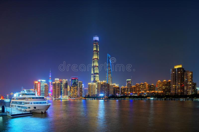 Shanghai Downtown with a boat and Huangpu River, China. Financial district and business centers in smart city in Asia. Top view of. Skyscraper and high-rise royalty free stock photography