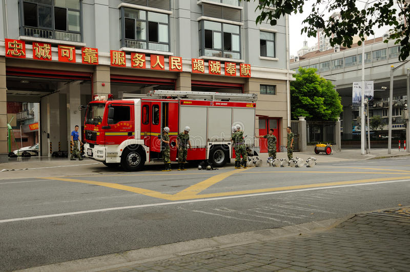Shanghai Fire Department. Conducting fire drills with their truck outside of the station stock photos