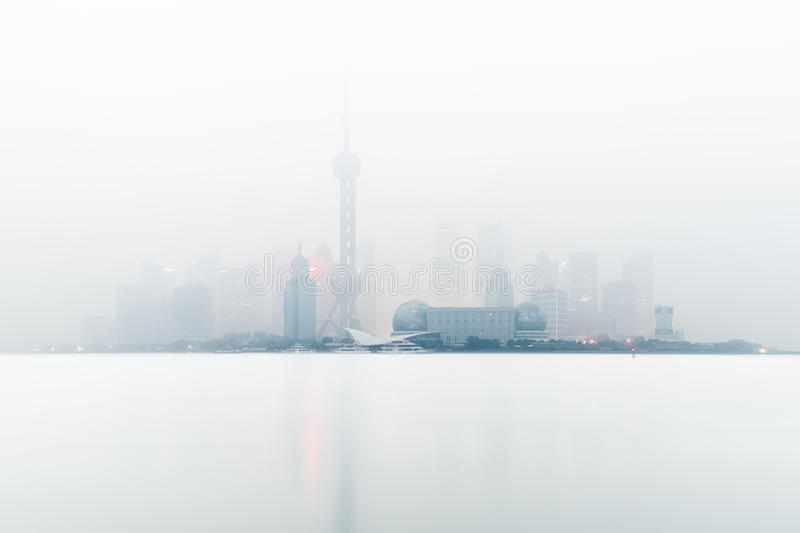 Shanghai in the fog royalty free stock images