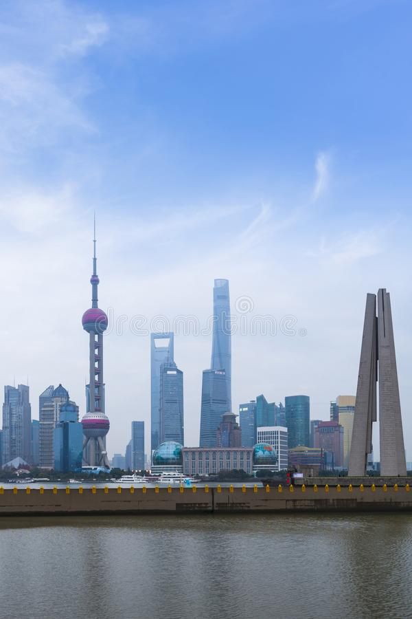 Shanghai high rises office and towers of the Business district skyline at mist behind a pollution haze, across Huangpu river, royalty free stock image
