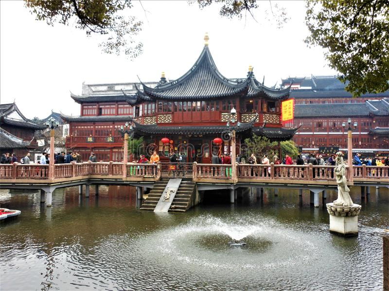 Shanghai Huxinting Teahouse in Yuyuan Garden. Tourism, people, water and fountain stock photography