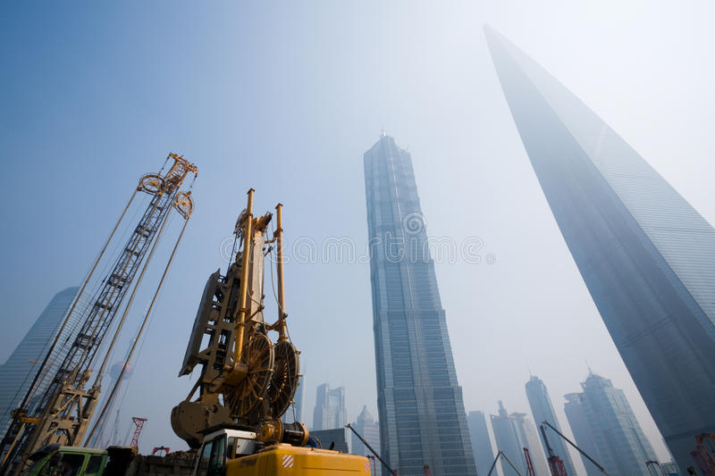 Shanghai.Lujiazui financial district. Lujiazui financial & Trade Zone in Shanghai. China.In the foreground the beginning of construction of new office building stock photo