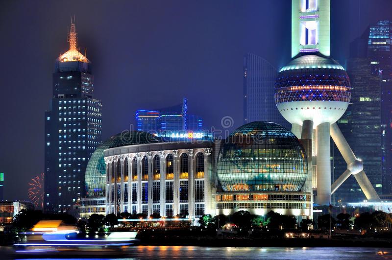 Shanghai oriental pearl tower and city night. Shanghai famous oriental pearl tower and commercial area in night lighting, shown as landmark of new shanghai city stock photo