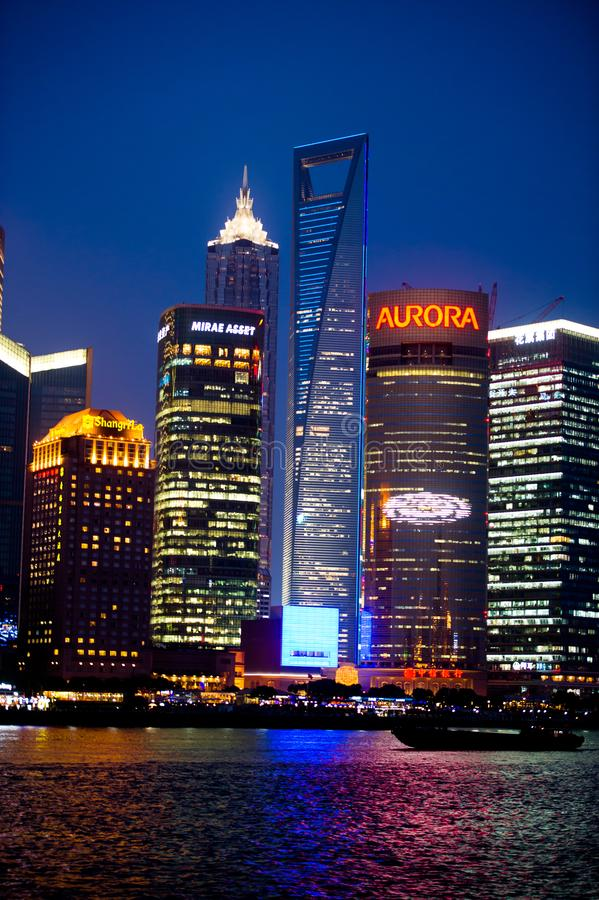 Shanghai skyscrapers with advertising in Pudong at night with World Financal Center royalty free stock photo