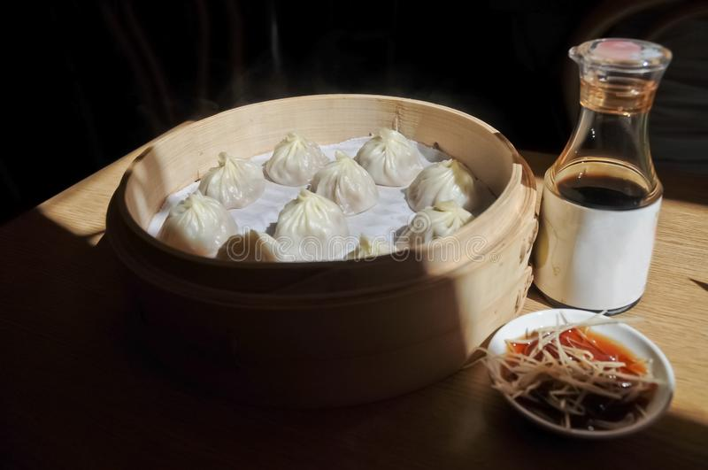 Shanghai soup dumpling steamed in bamboo bowl - Xiao Long Bao ma royalty free stock photo