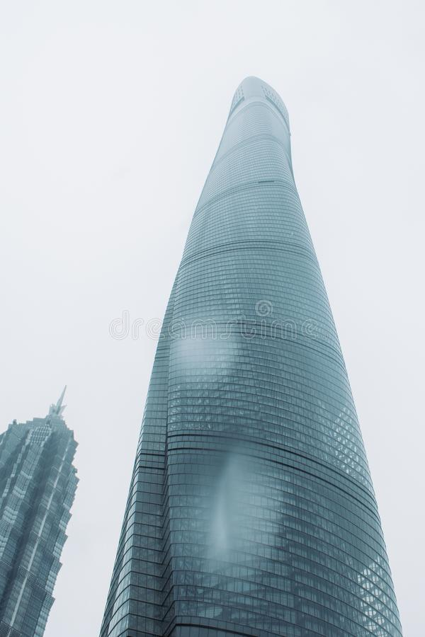 Free Shanghai Tower On A Cloudy Day With The Skyscrapers Covered In Clouds And Mist Stock Photos - 136436373
