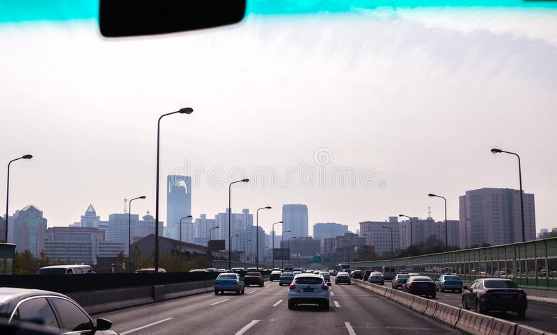 SHANGHAI Traffic against skyline. SHANGHAI 2015:Traffic against Shanghai skyline, Shanghai is the largest Chinese city by population and the largest city proper royalty free stock photo