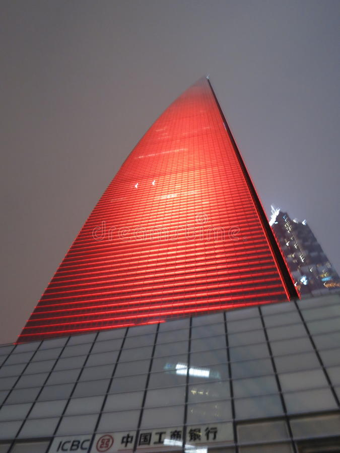 Shanghai World Financial Center in Red. FEBRUARY 2013 - SHANGHAI: Looking up at the Shanghai World Financial Center in red lights stock images
