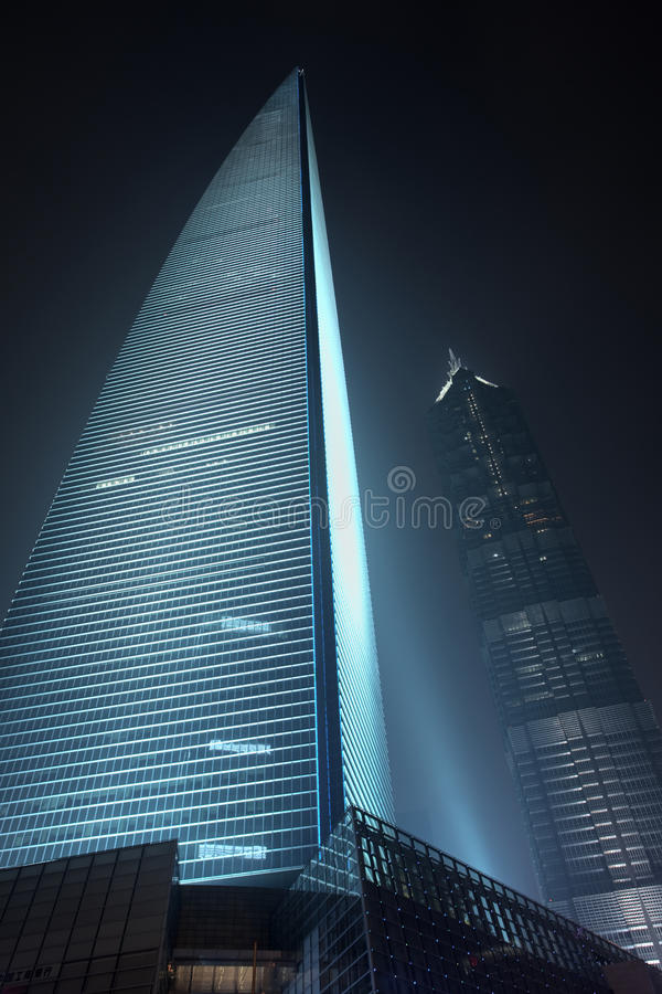 Shanghai World Financial Centre at night, China. SHANGHAI – NOV. 21, 2010. Shanghai World Financial Center SWFC and Jin Mao Tower background. SWFC at royalty free stock photo