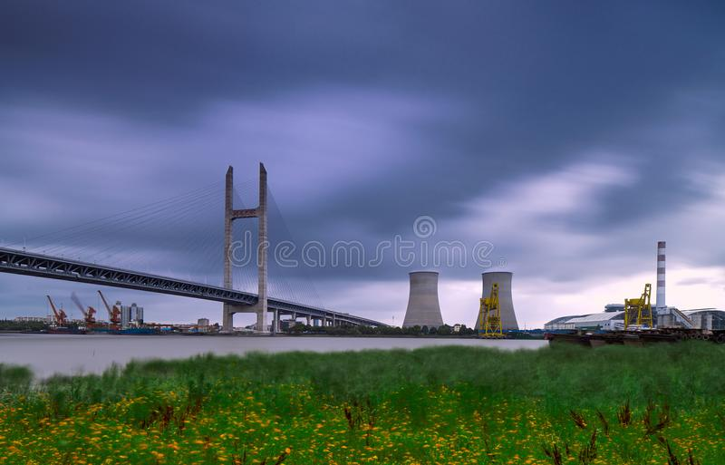Shanghai Zhapu Bridge and Thermal Power Plant. 。This is a power plant built on the edge of the city. It is built on the river and provides electricity to royalty free stock photos