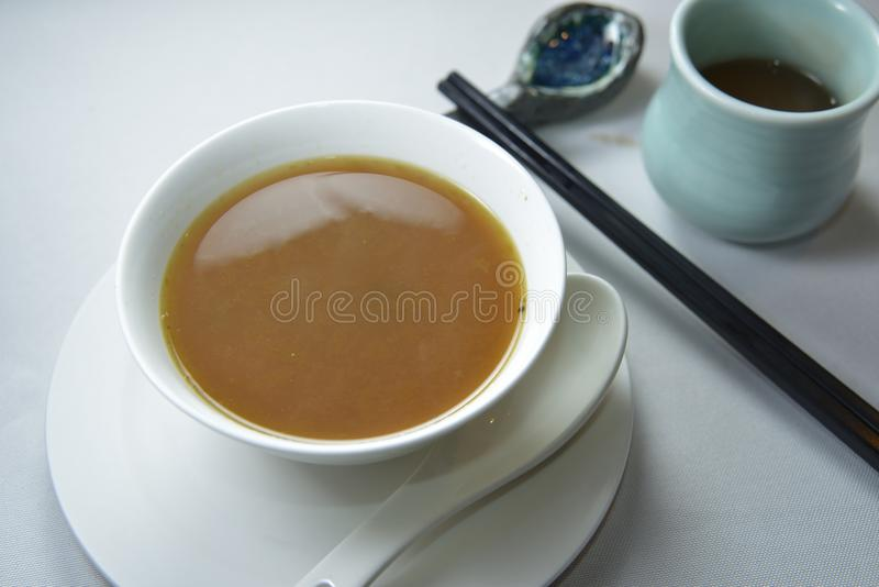Veggie soup. Shanghainese veggie chicken soup in bowl stock images